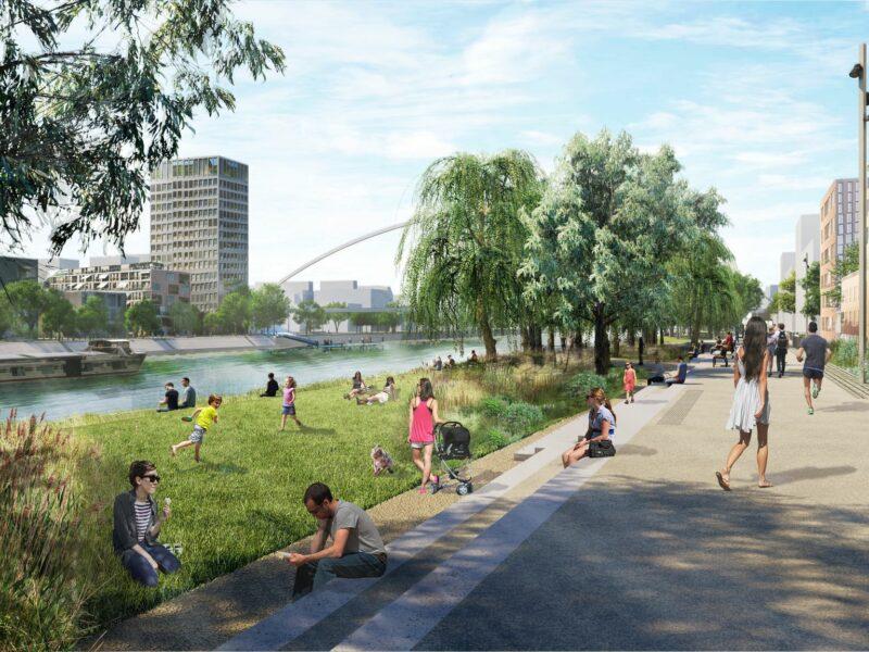 Vue perspective de la promenade des quais du quartier Starlette avec des gens assis sur l'herbe et le pont André Bord au fond. Crédits Agence TER